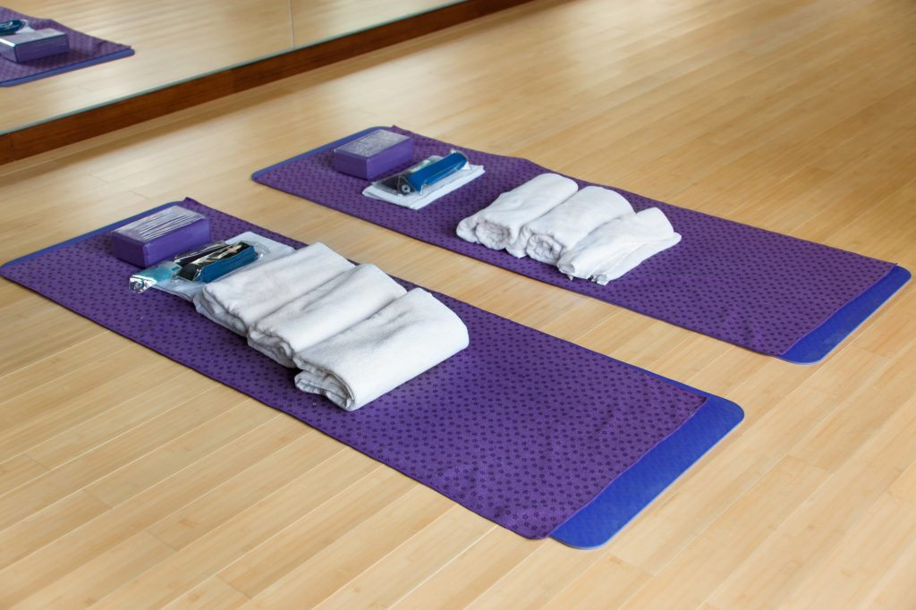 Yoga mats and yoga towels ready to be used